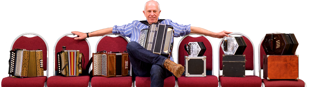 Photo of John Kirkpatrick with accordions on chairs